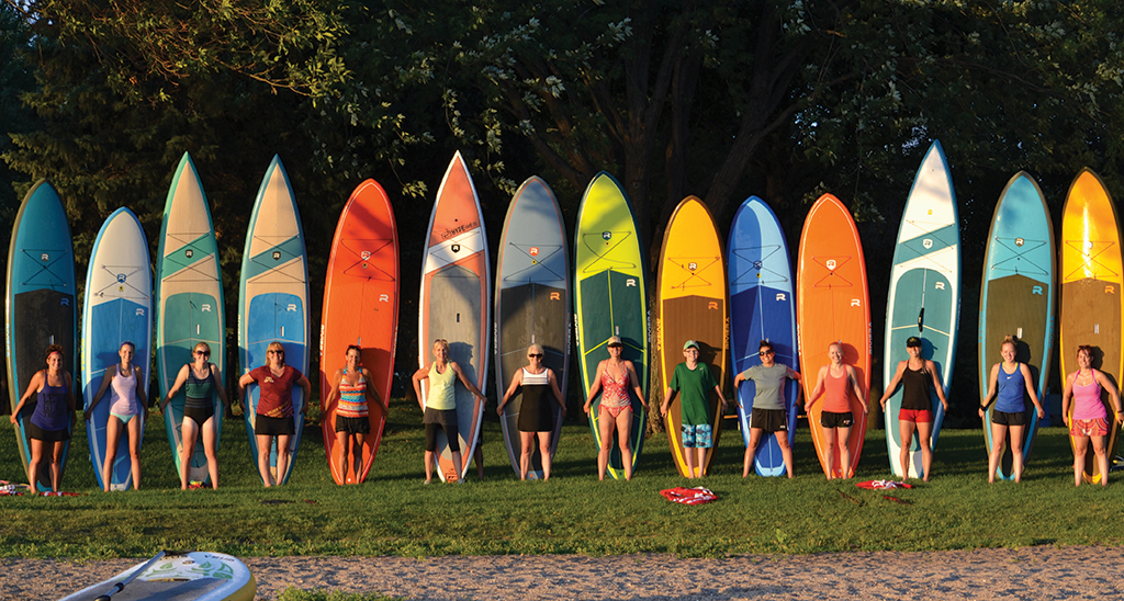 Group Of People With Paddleboards